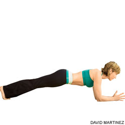Activating the core in plank pose.